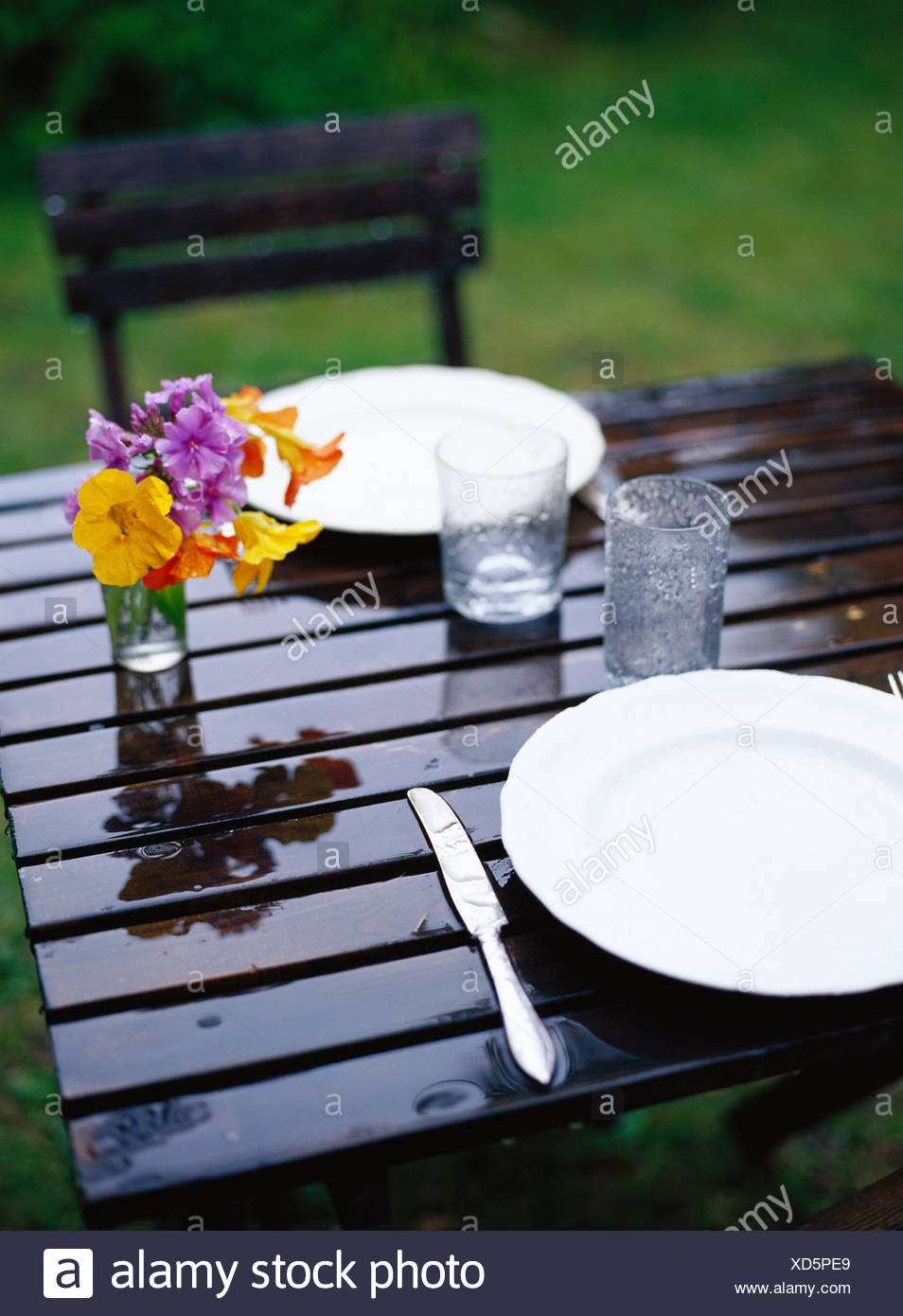 Raining on a table ready laid, Sweden. - Stock Image