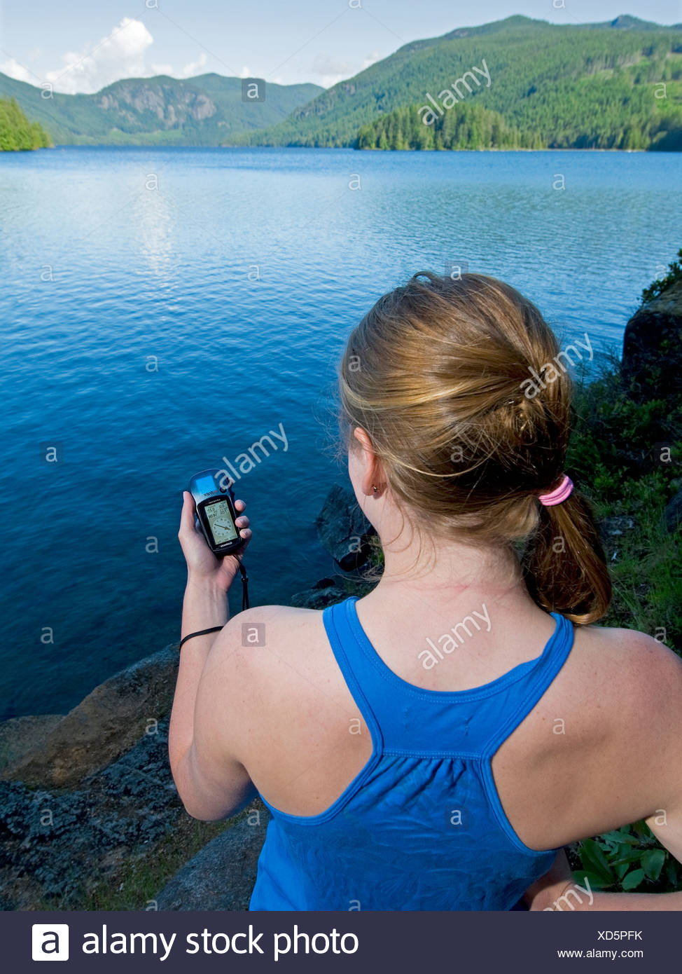 young woman geocaches you use GPS hide seek - Stock Image