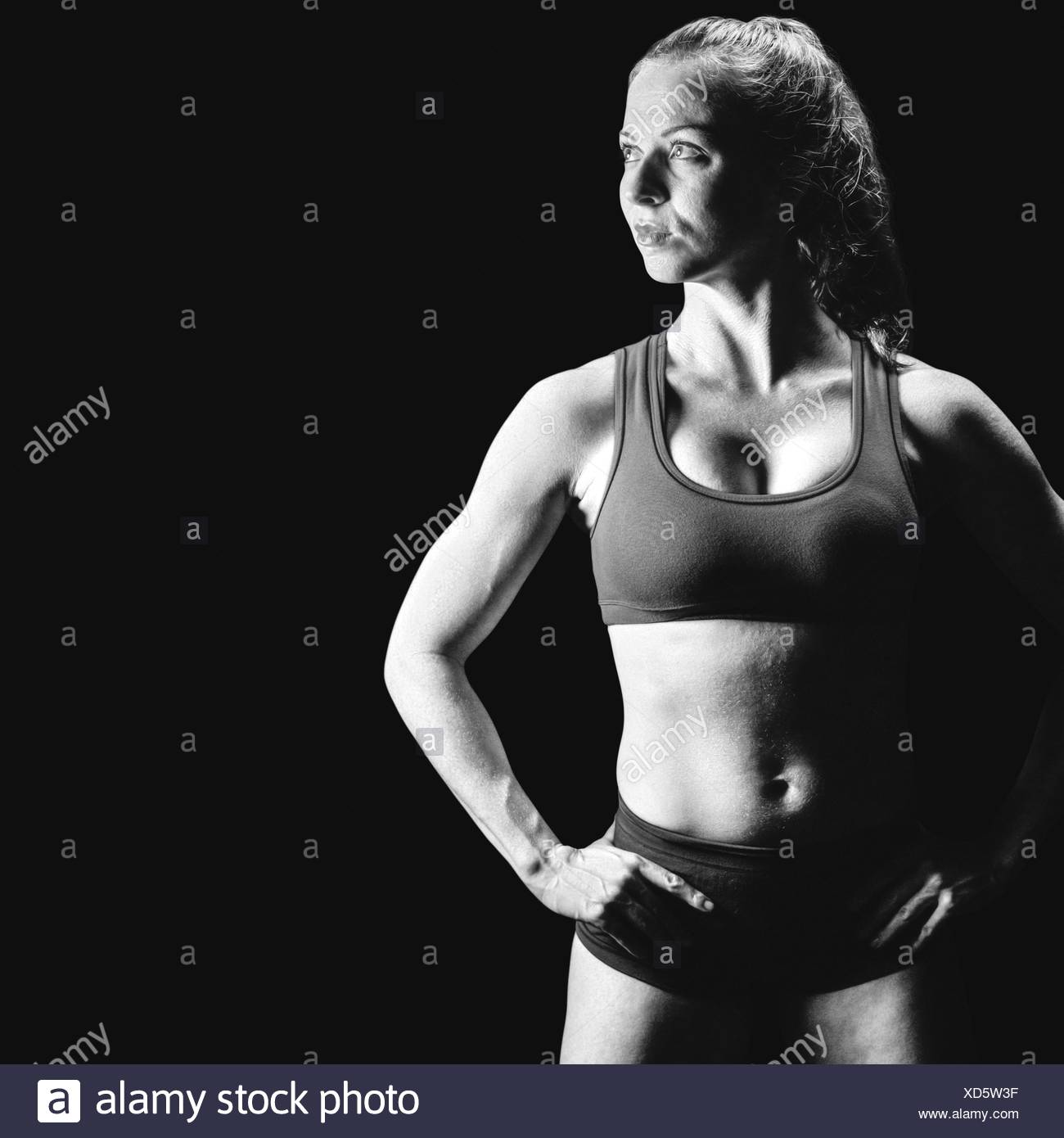 Composite image of confident bodybuilder with hand on hip - Stock Image