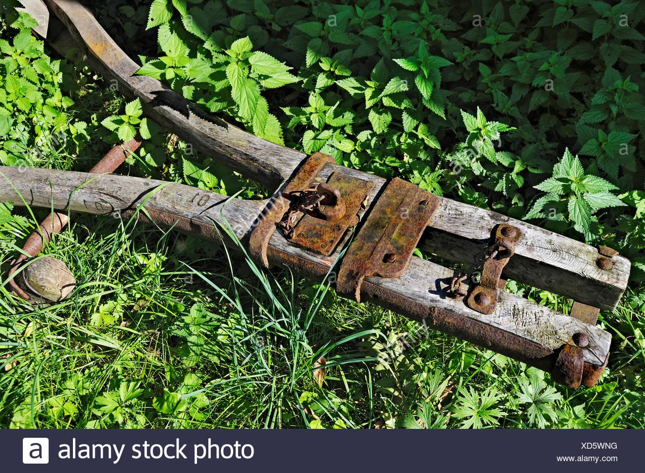 Old wagon tongue and stinging nettles, Bavaria Stock Photo