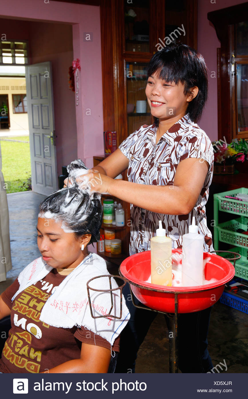 Young woman washing hair during a hairdressing apprenticeship, vocational training center, Siantar, Sumatra, Indonesia, Asia - Stock Image