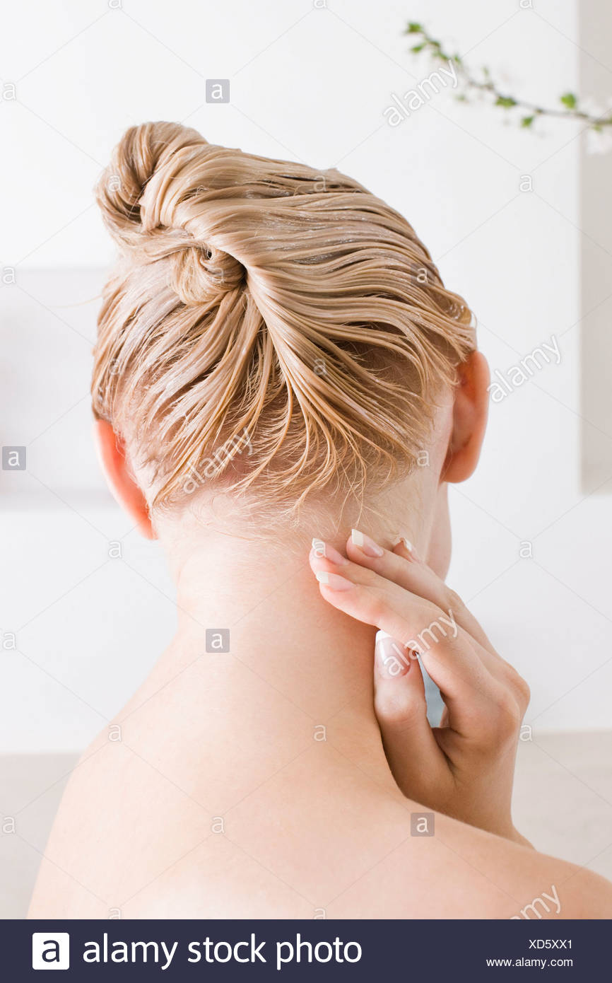 Woman with hair conditioner - Stock Image
