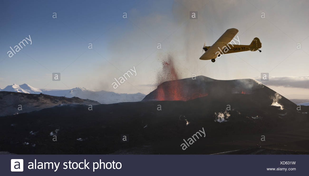 Cessna plane-volcano eruption in Iceland at Fimmvorduhals, a ridge between Eyjafjallajokull glacier and Myrdalsjokull Glacier. - Stock Image