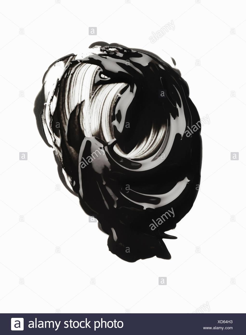 Swirly smudge of glossy mascara - Stock Image