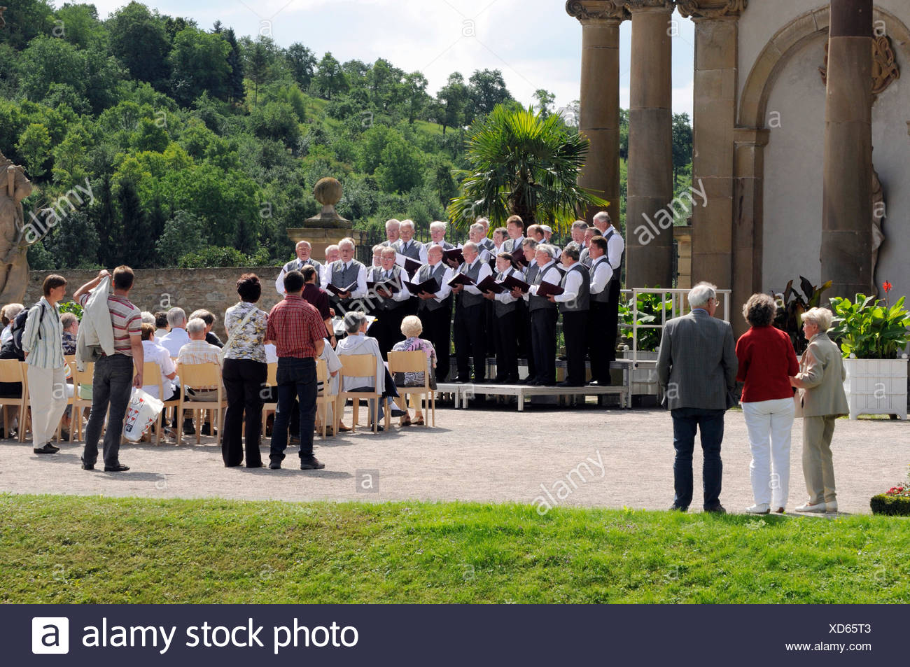 Park Concert of the Saengerbund Harmonie Weikersheim or the Weikersheim Harmony Singing Club, choir in front of the Orangerie of - Stock Image