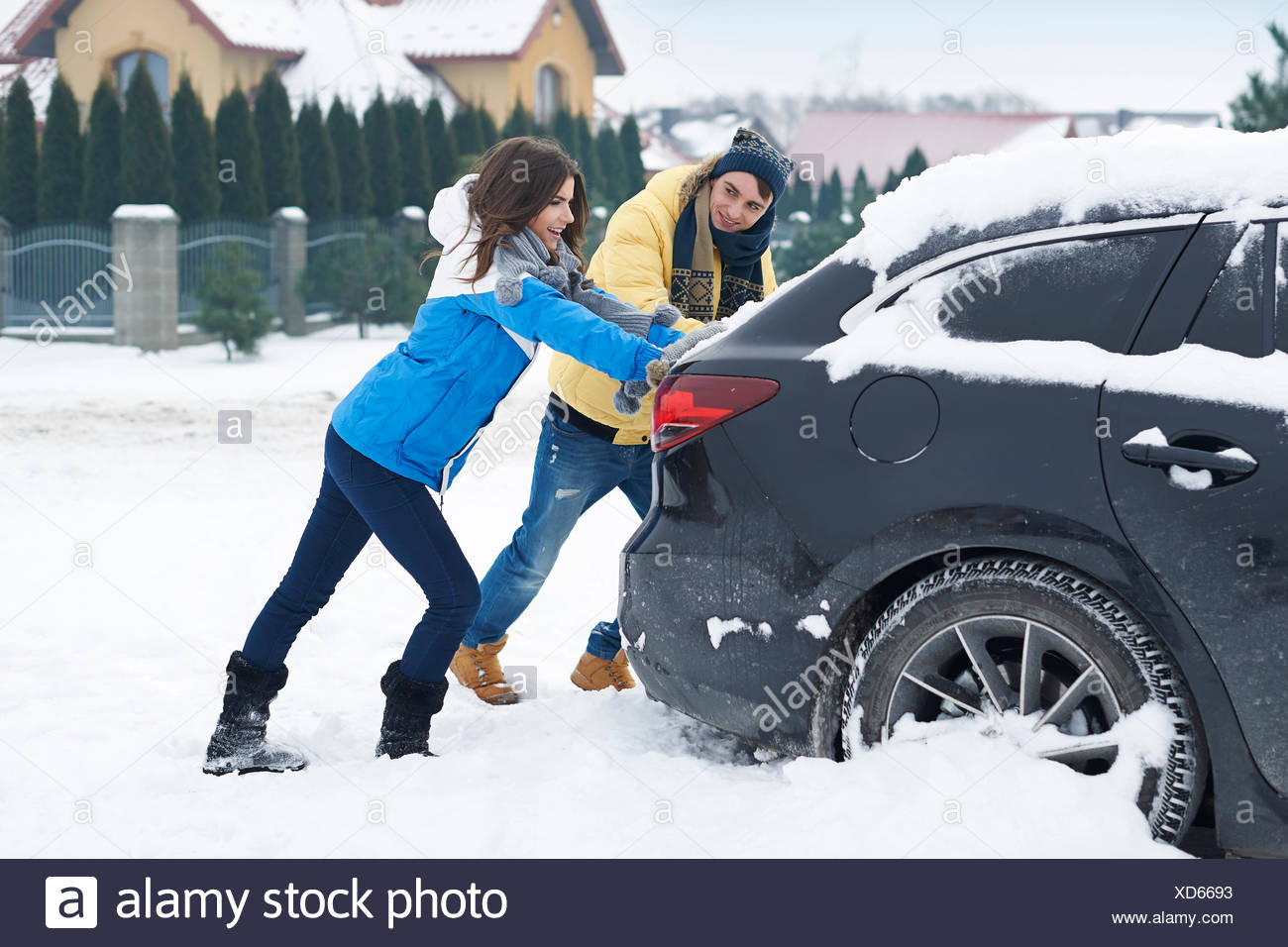 Stuck car in snowdrift is big problem for us. Debica, Poland - Stock Image