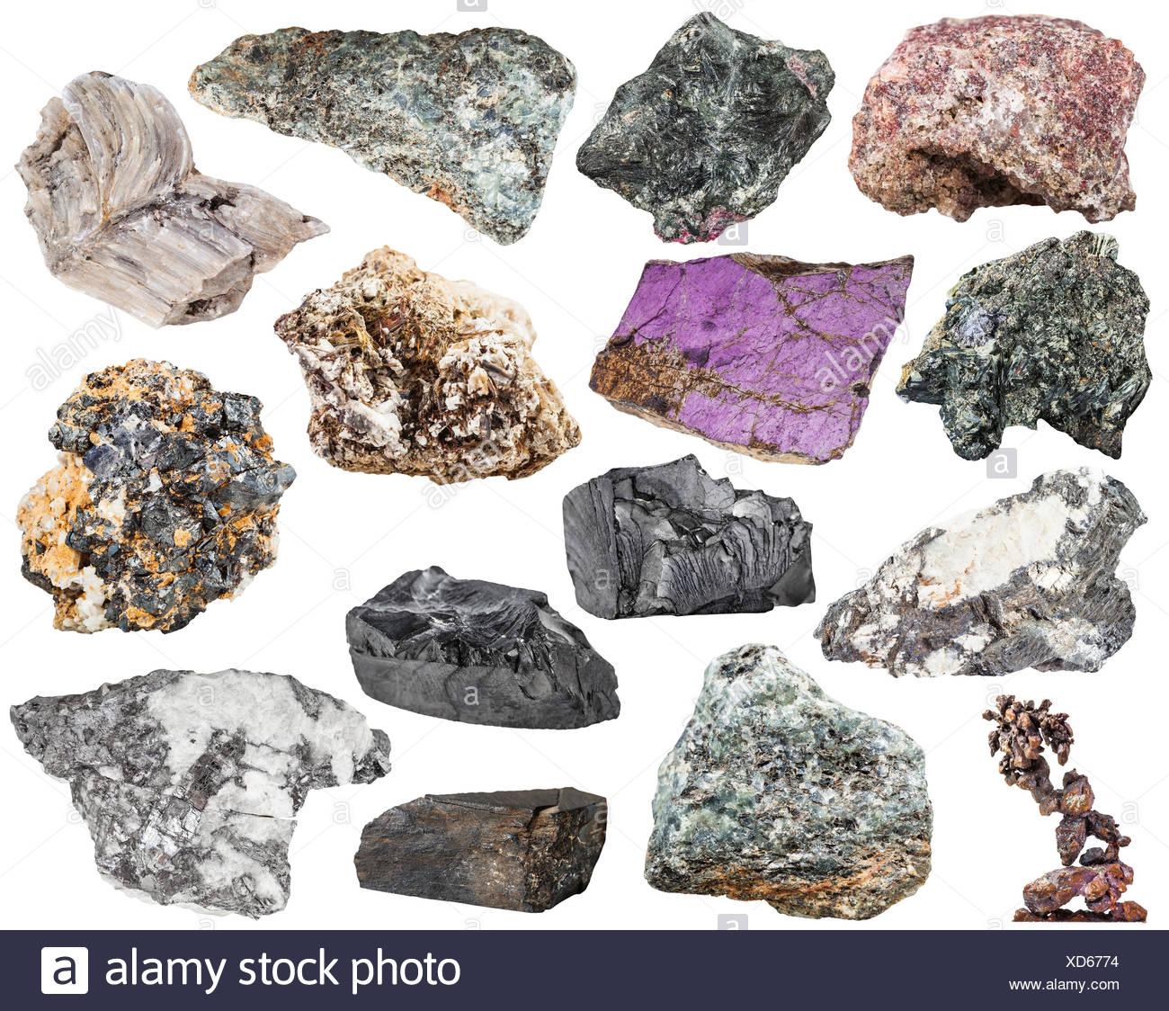 set of various natural mineral stones and rocks - baryte, barite, bismuthinite, bismuth, molybdenite, glaucophane, jet, lignite, shungite, shungit, nepheline, galena, etc isolated on white background - Stock Image