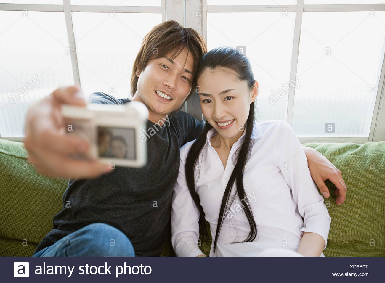 Couple taking a picture of themselves - Stock Image