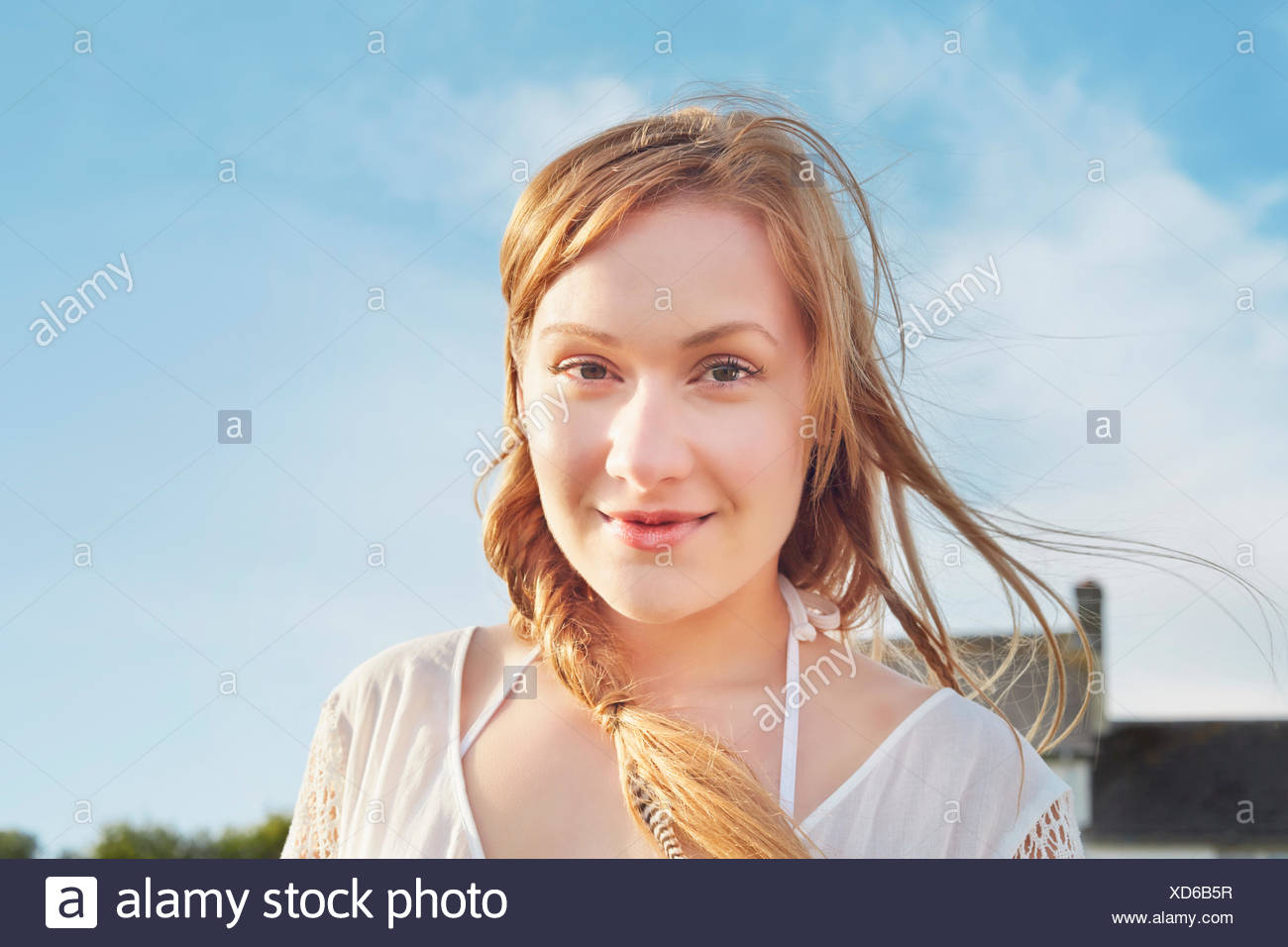 Portrait of serene young woman - Stock Image
