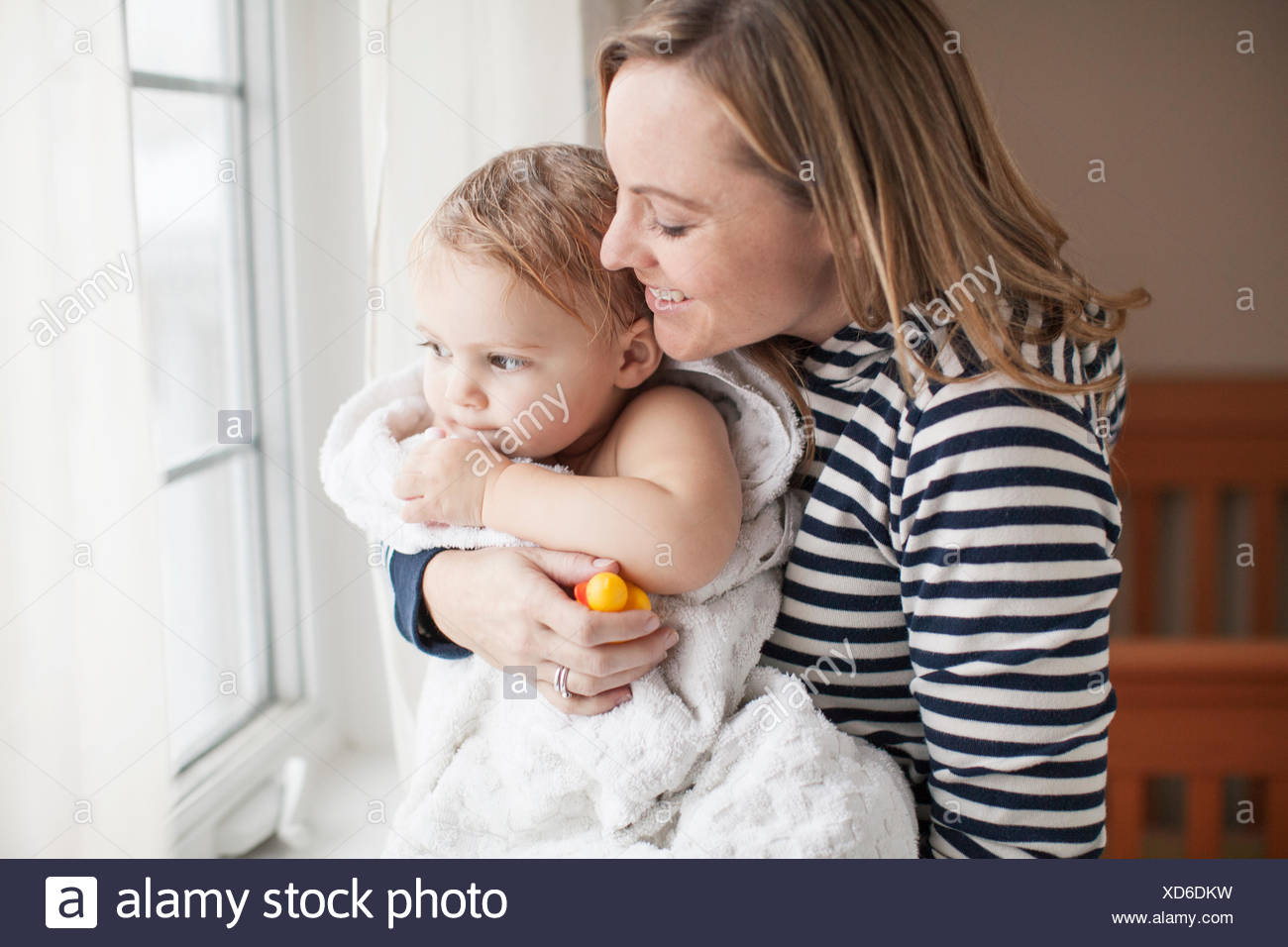 Mother snuggling baby girl after her bath Stock Photo