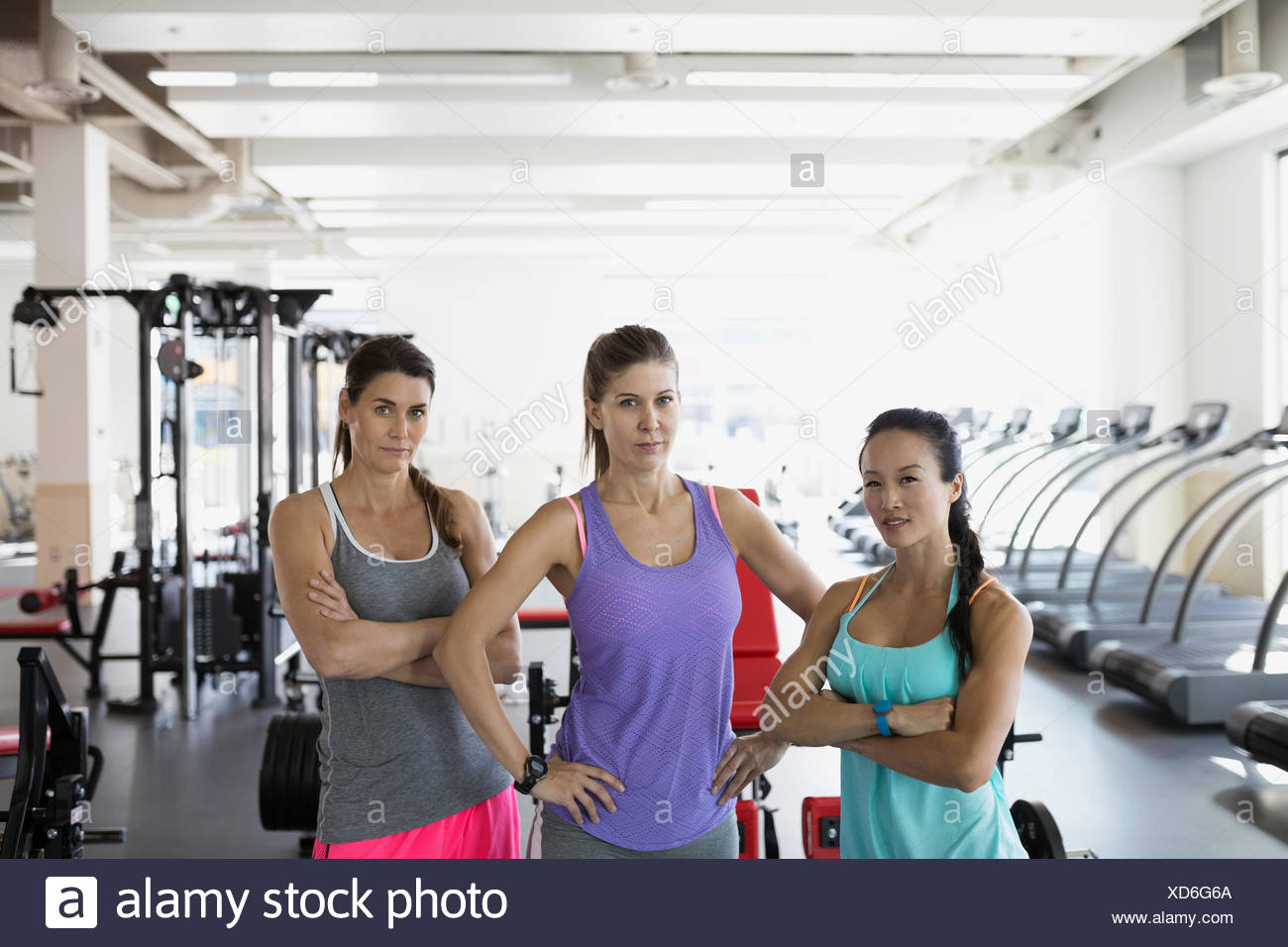 Portrait confident women expressing attitude in gym - Stock Image