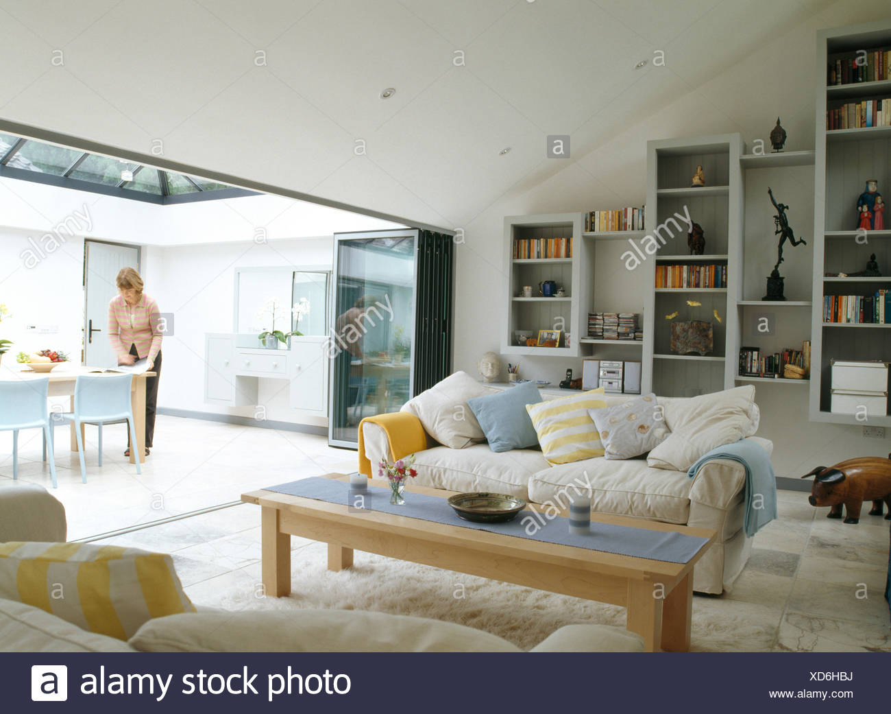 Charmant Modern Living Room With View Of Woman Setting The Table In Dining Area FOR  EDITORIAL USE ONLY