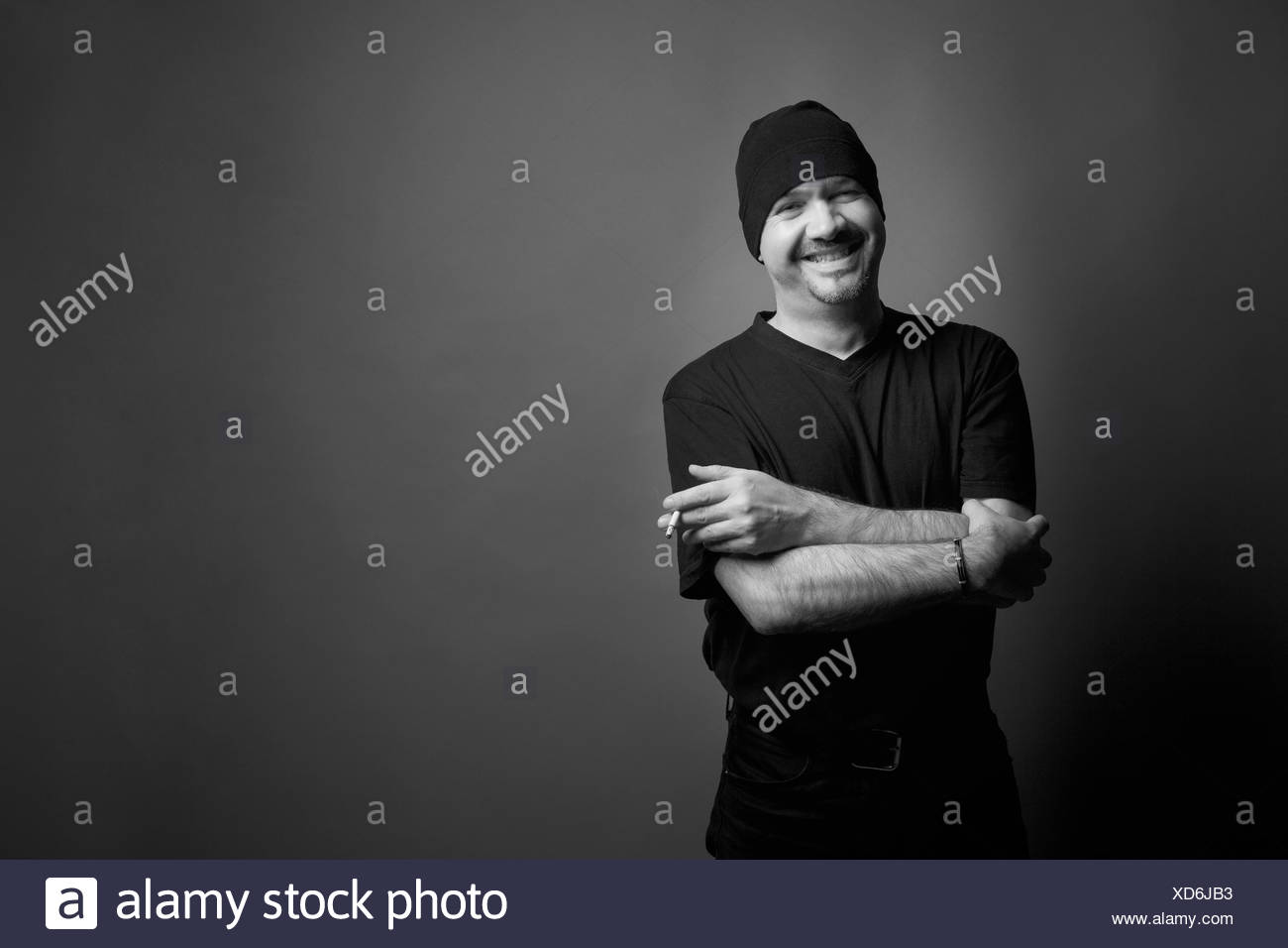 Black and white portrait man smoking cigarette - Stock Image
