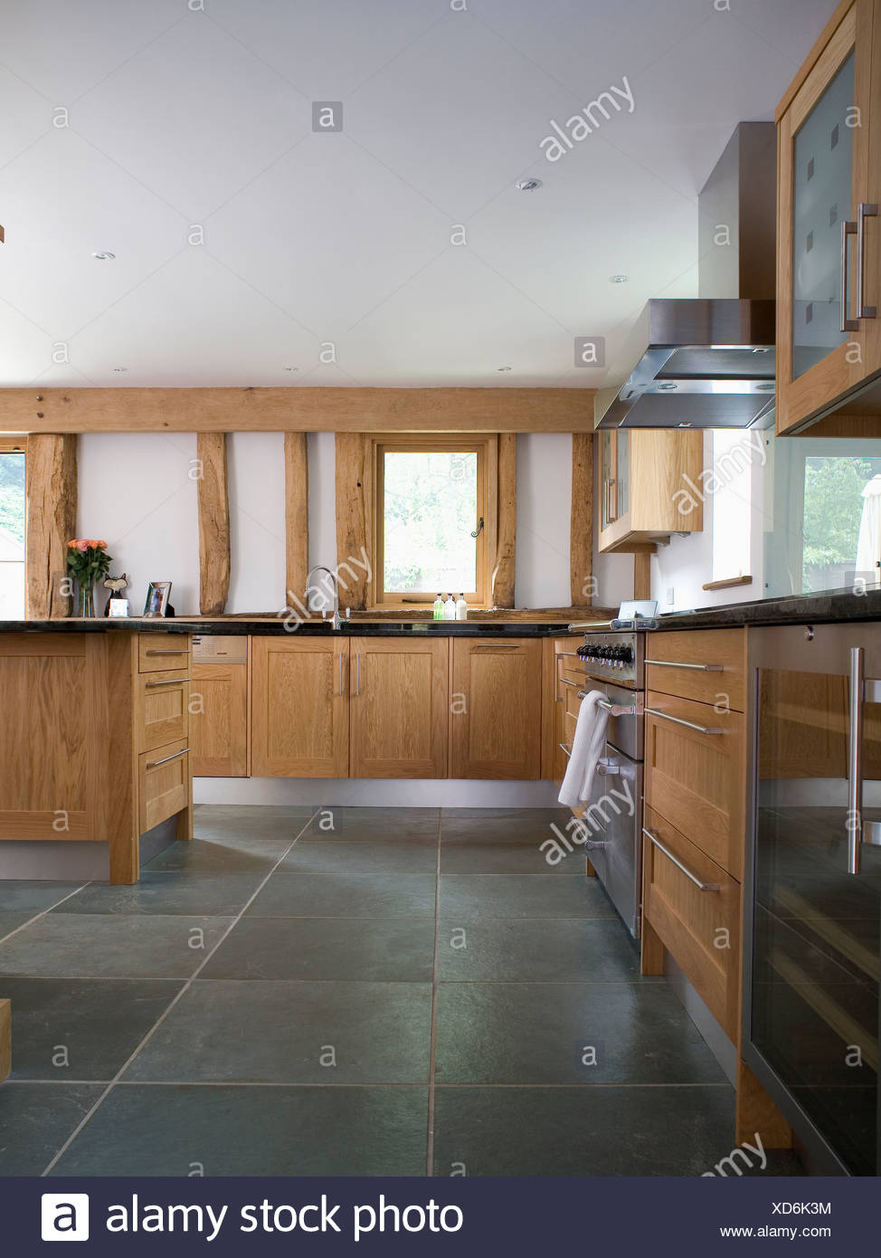 Slate flooring in large modern country kitchen with pale ...