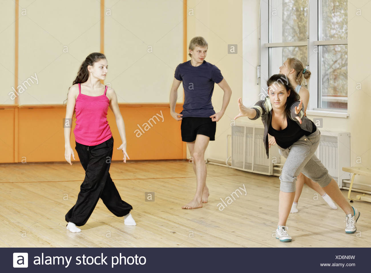 Trainer demonstrates exercise - Stock Image