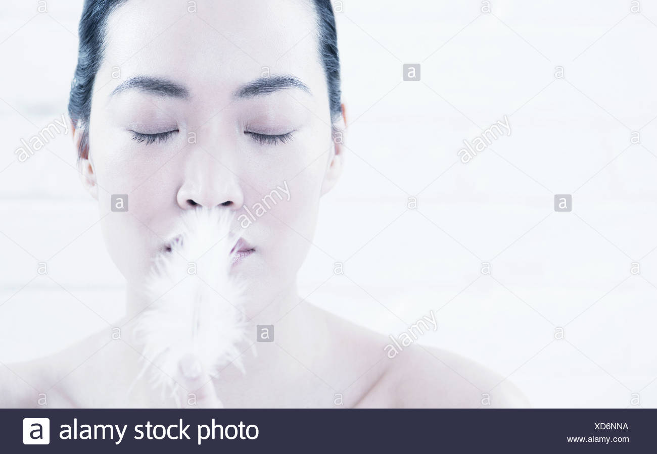 Woman breathing in powder Stock Photo