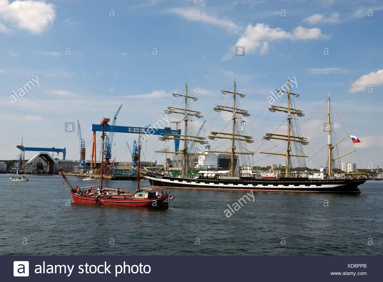 Russian Tall Ship, Kruzenshtern, and other tall ships in front of the crane of the Howaldtswerke-Deutsche Werft, HDW Shipyard, - Stock Image