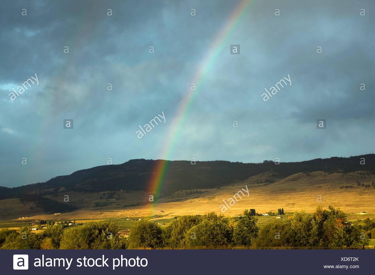 Rainbow over picturesque landscape, British Columbia, Canada - Stock Image