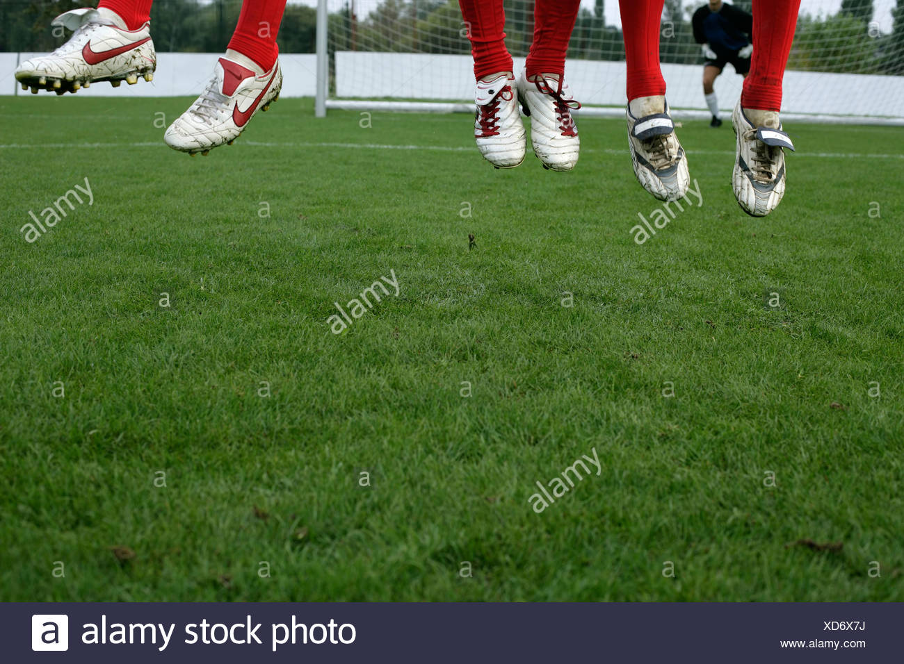 Soccer players in a wall jumping - Stock Image