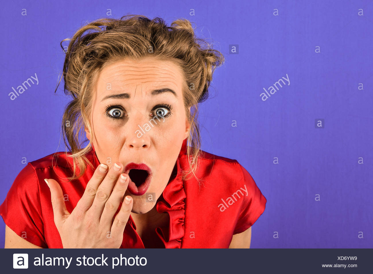 Blonde woman is scared - Stock Image