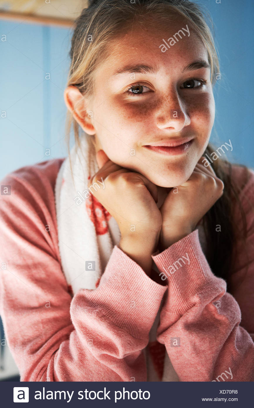 Portrait of a teenage girl smiling. - Stock Image