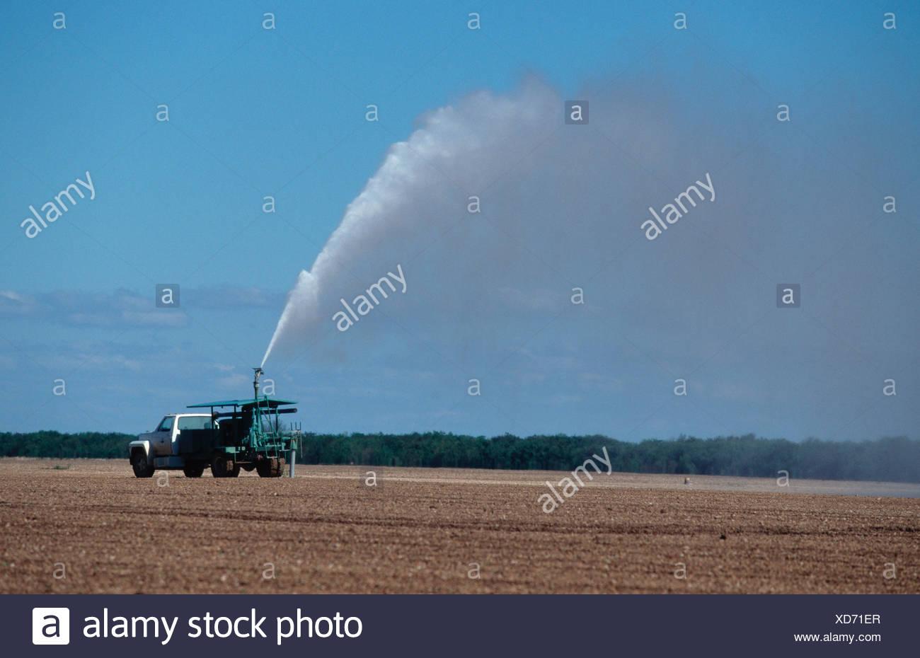 Pumper Truck plying fields Everglades Florida USA - Stock Image