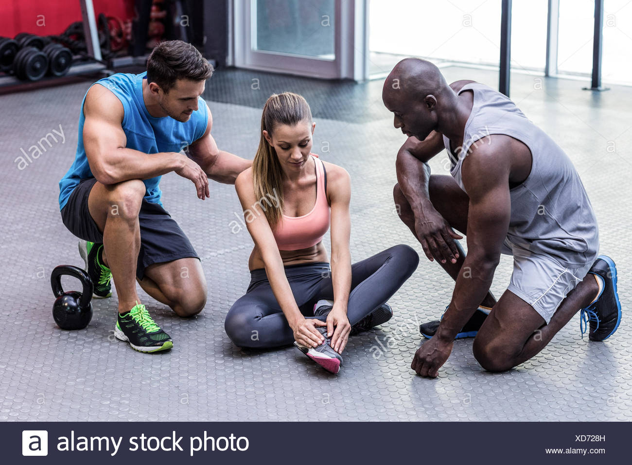 Muscular woman having an ankle injury - Stock Image