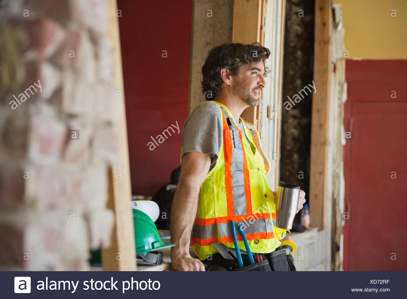 Take Break Coffeebreak : Tradesman taking coffee break at construction site stock photo