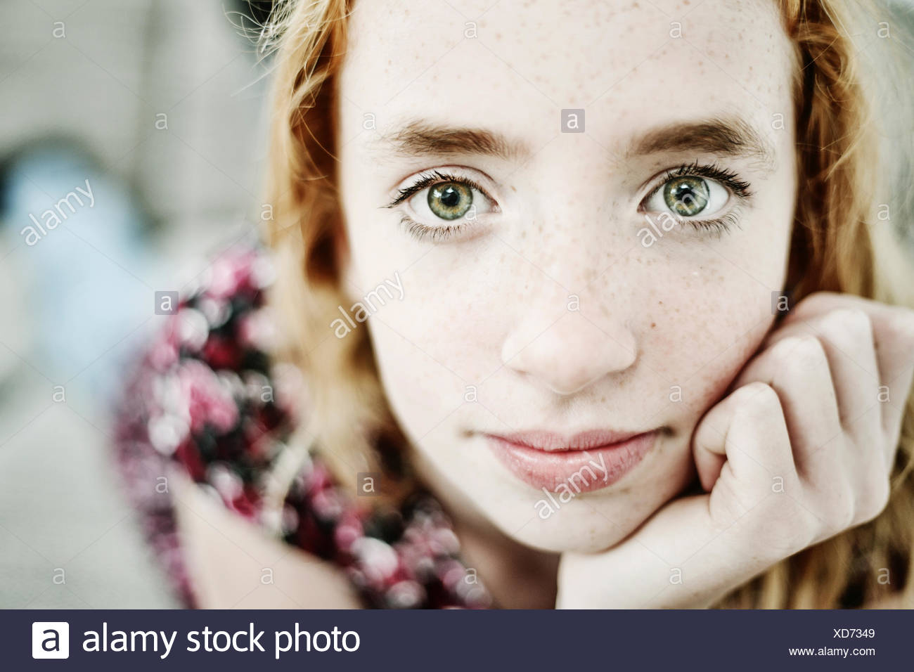 Portrait of daydreaming girl   green eyes - Stock Image