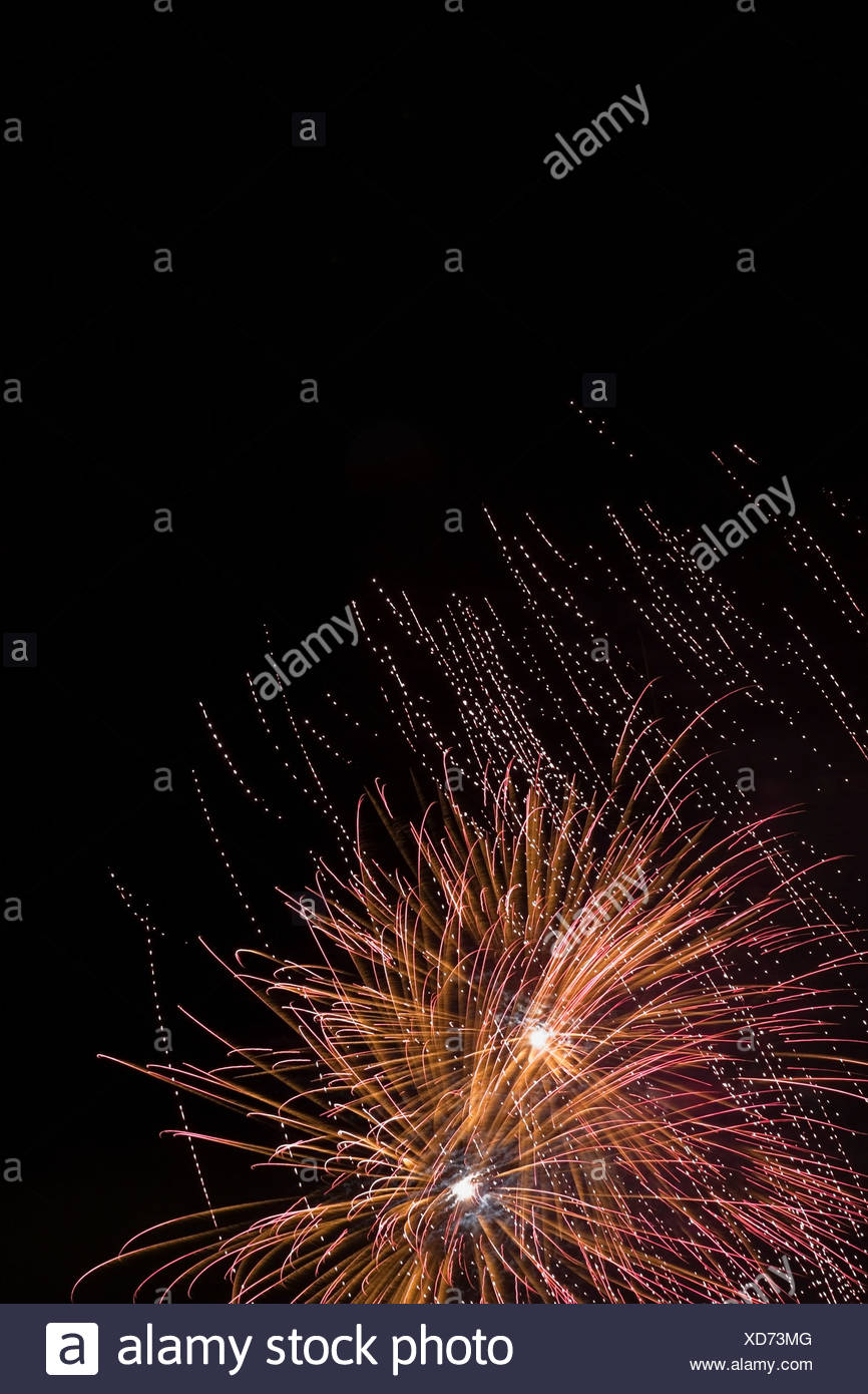 Fireworks exploding against night sky - Stock Image