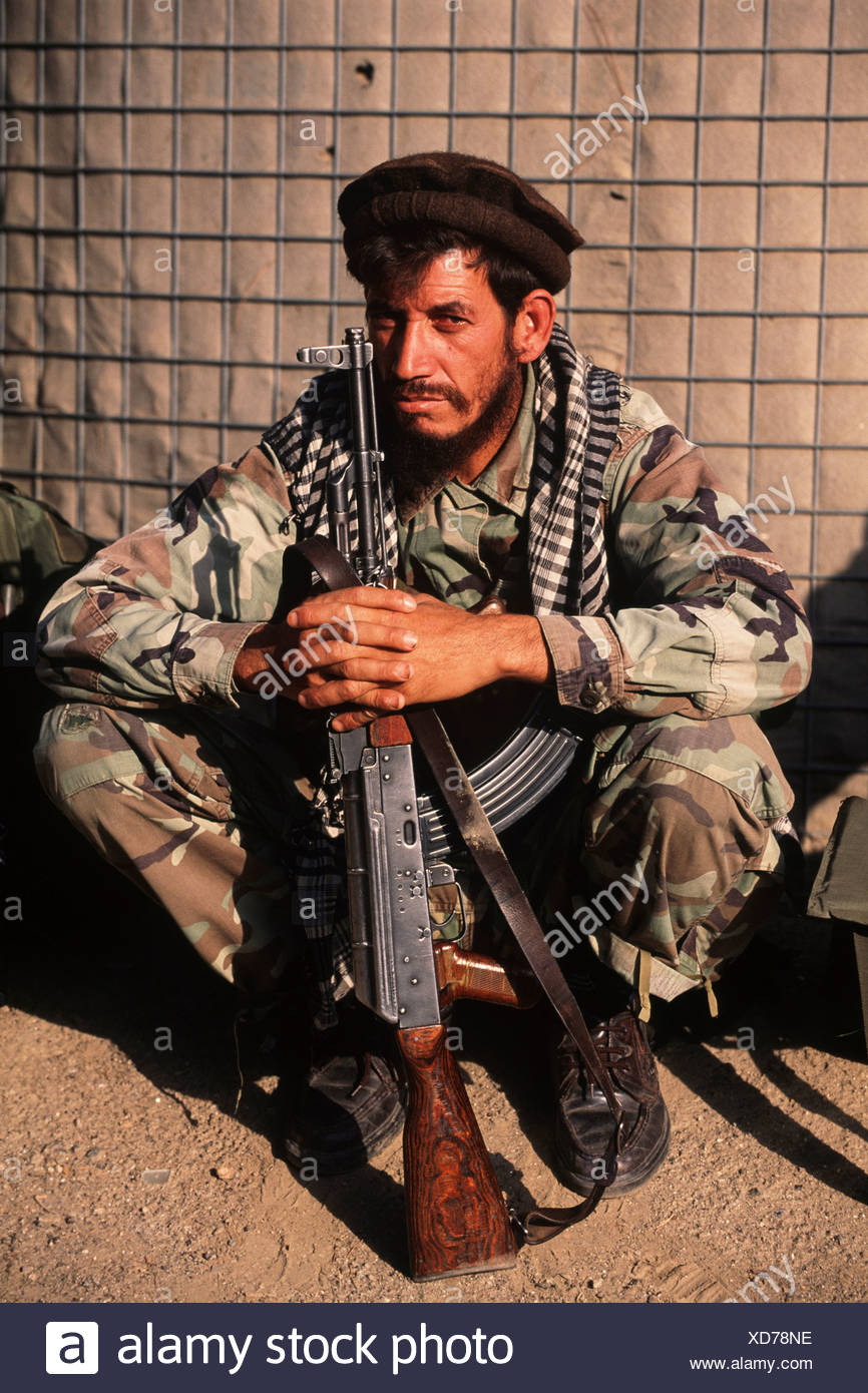 An Afghan Fighter with AK-47 - Stock Image