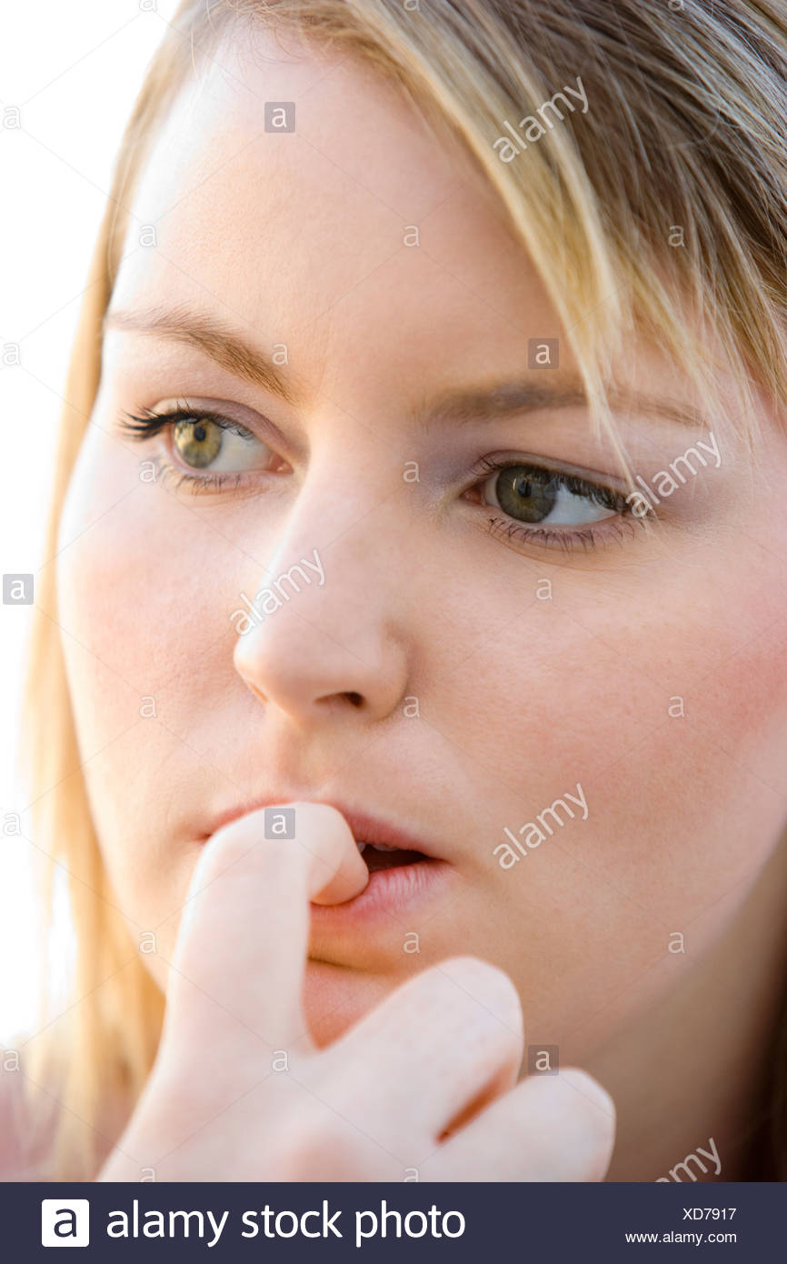 Head shot of worried woman - Stock Image