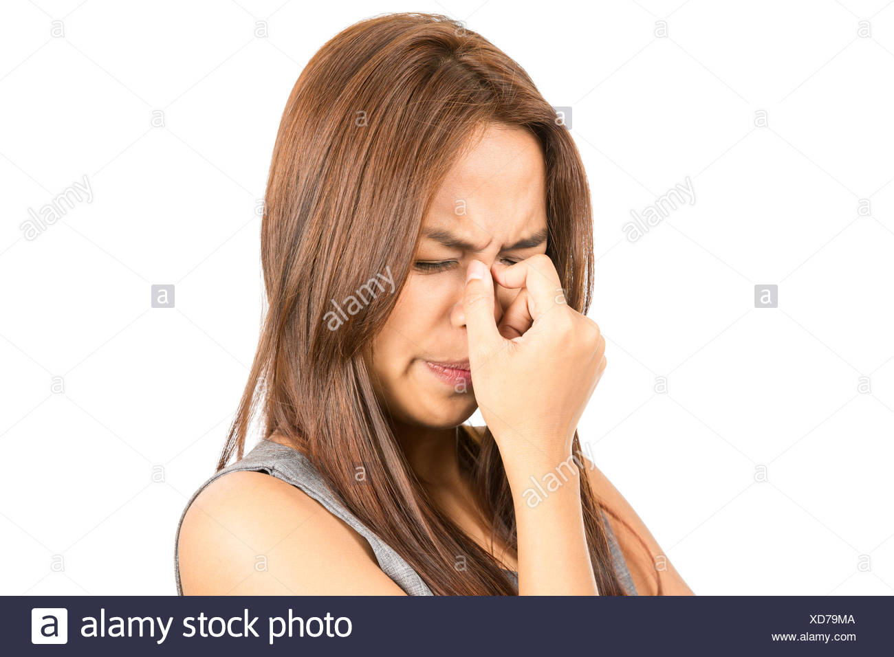 Close Up Frowning Asian Woman Headache - Stock Image