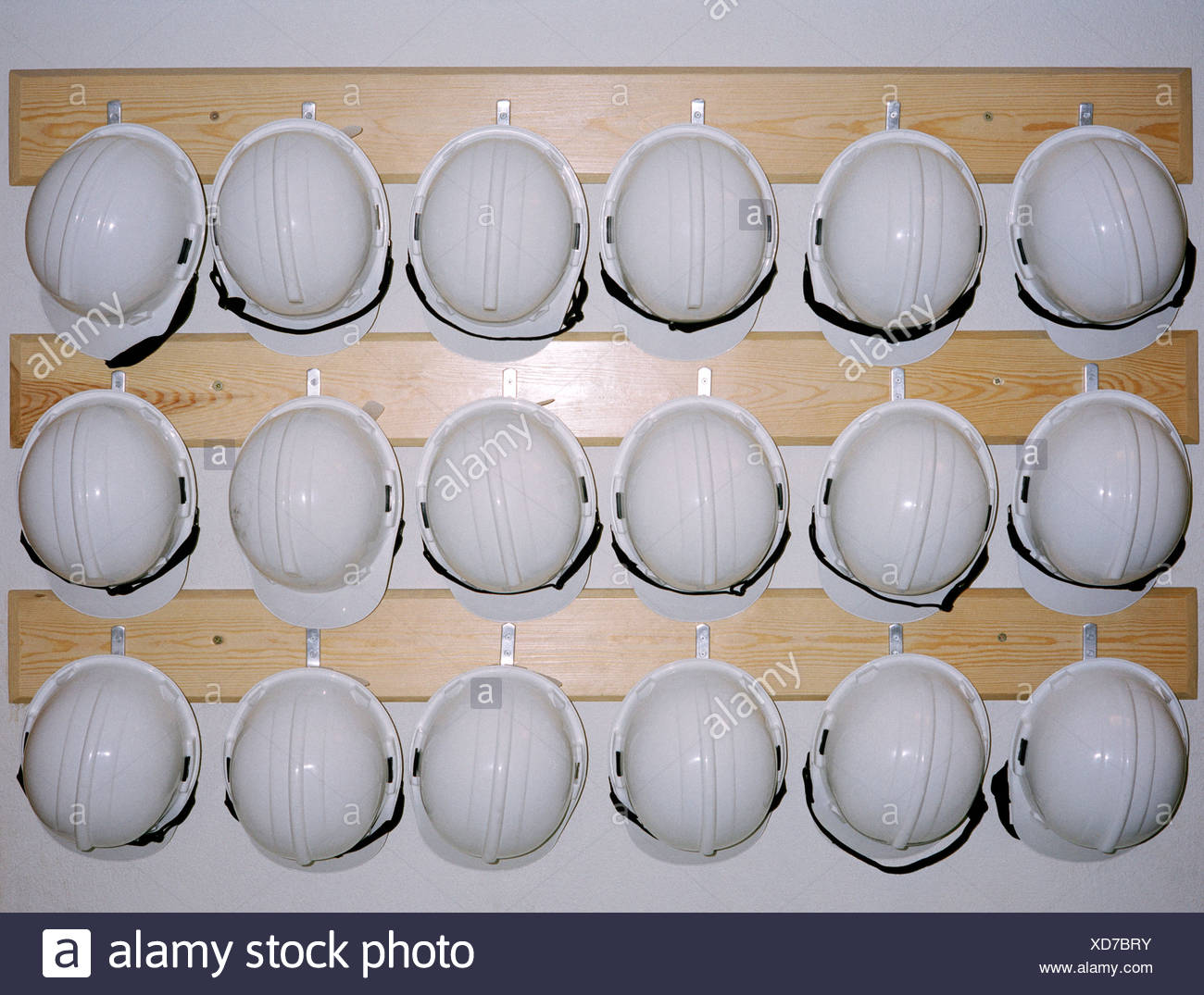 Rows of hardhats - Stock Image