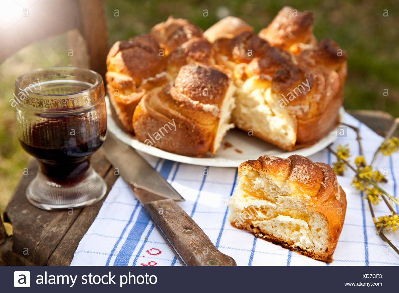 Cake on table with glass of red wine Stock Photo