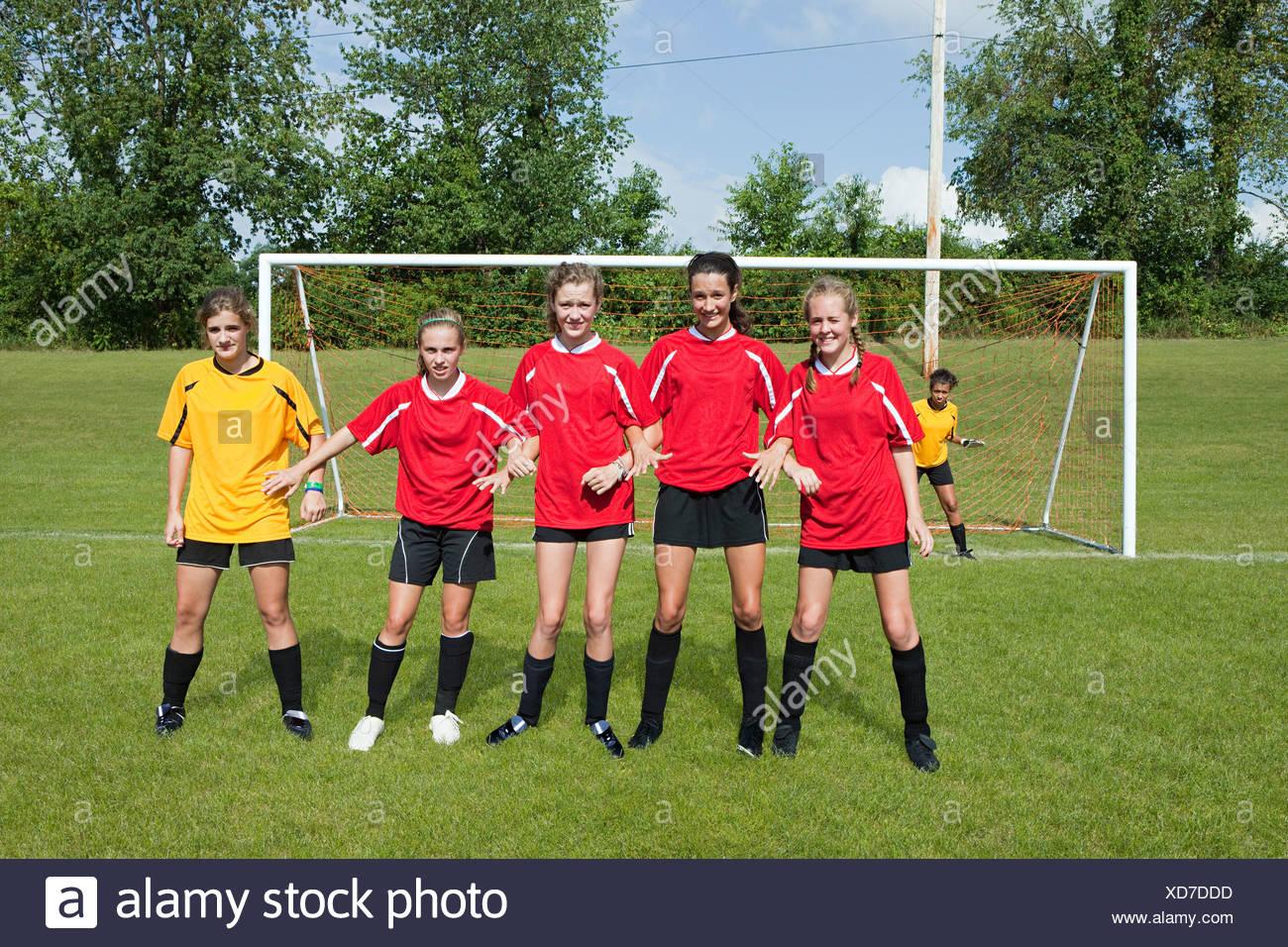 Girl soccer players make defensive wall - Stock Image