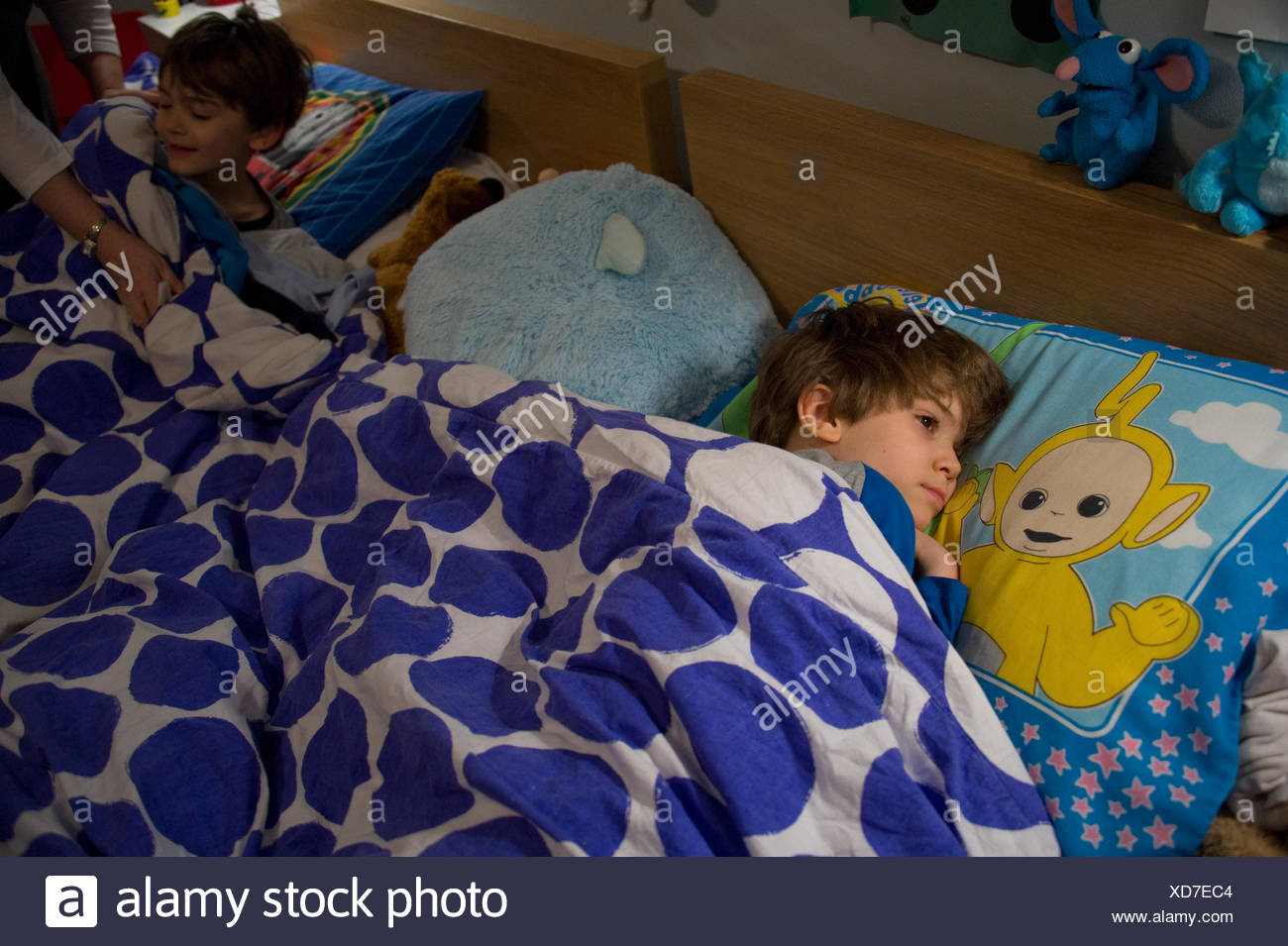 Twin boys who function on the opposite ends of the autism spectrum. - Stock Image