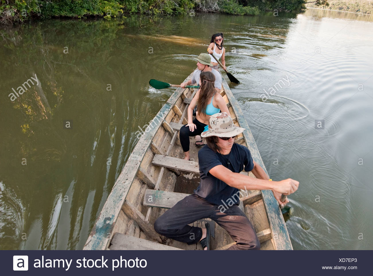 A group of young people paddling a canoe and having fun on lake sandoval. - Stock Image