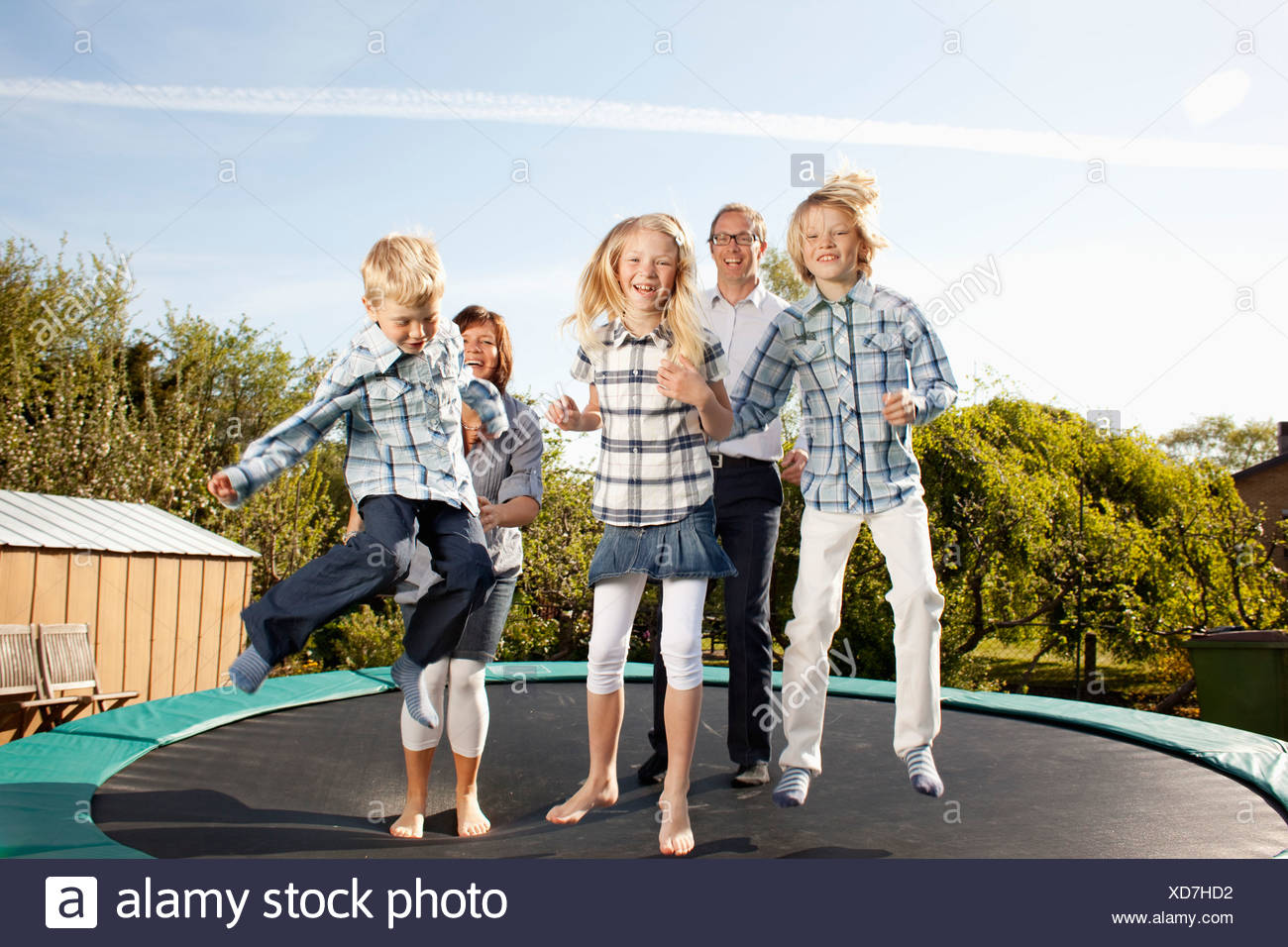 Family jumping - Stock Image