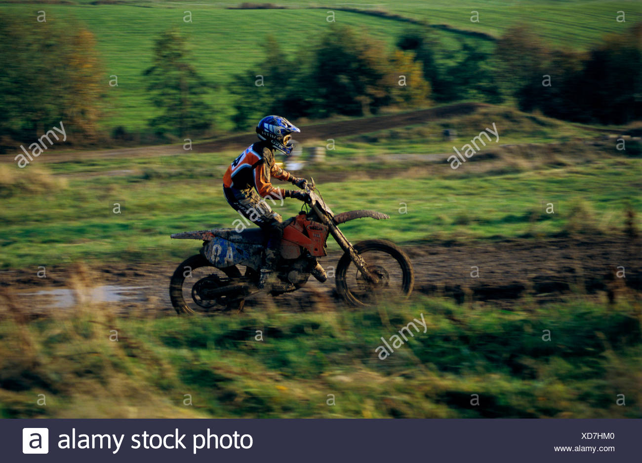 Motocross driver on an off-road ride - Stock Image