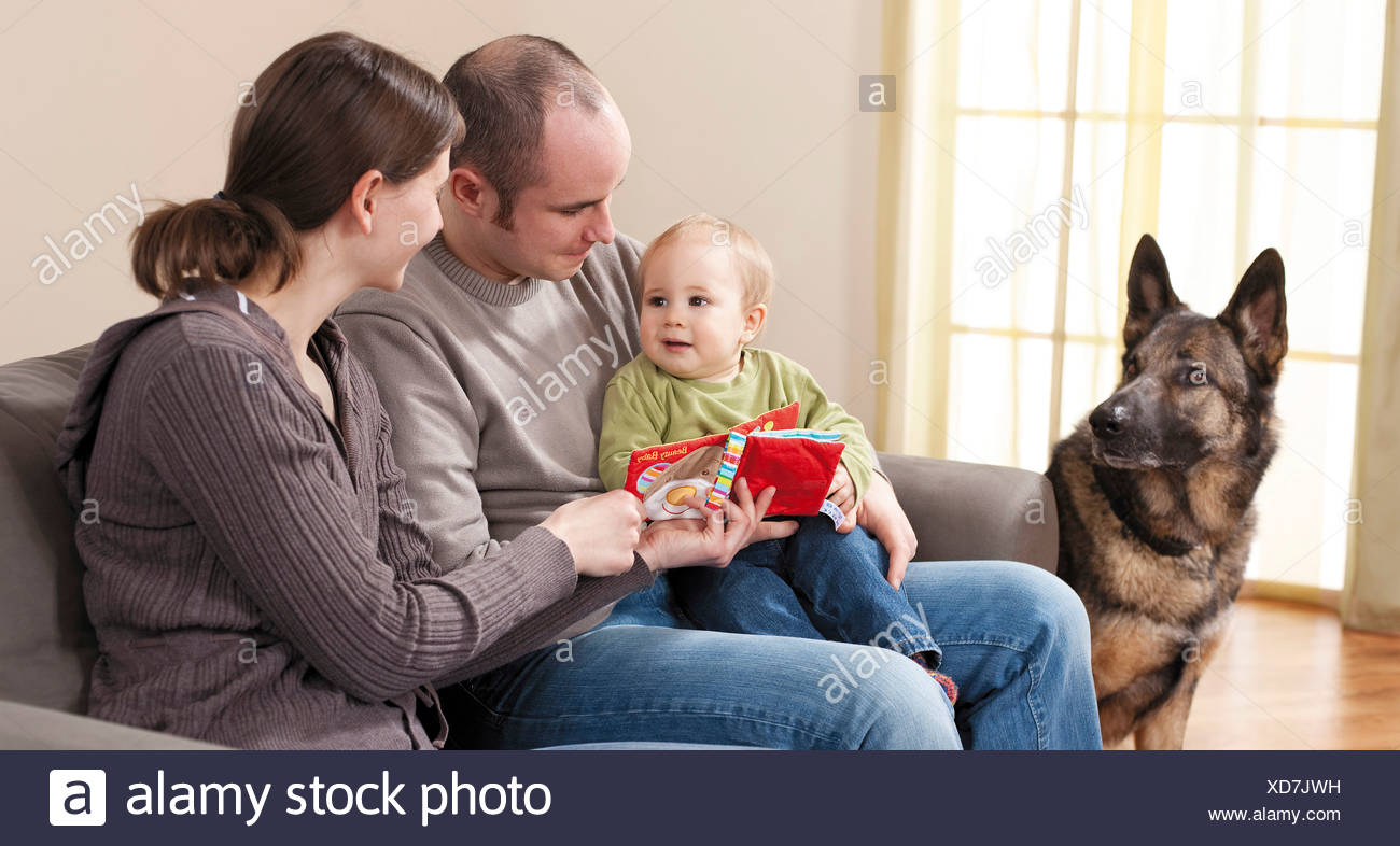 family with German Shepherd dog - Stock Image