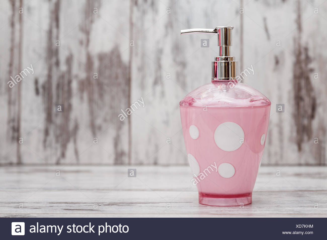 Cute pink bathroom accessories on white wooden background Stock ...
