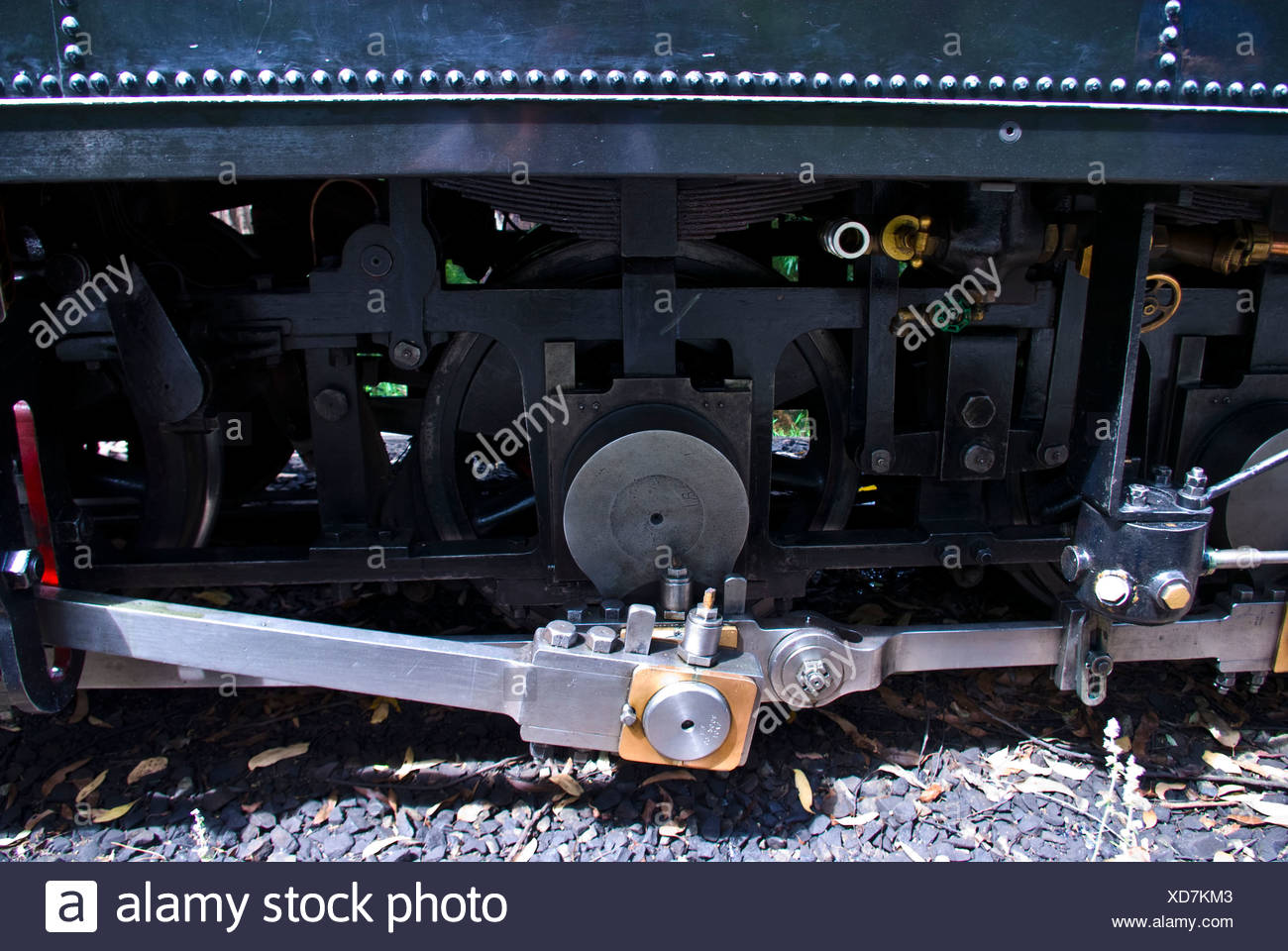 Coupling rods connect the drive wheels together on a steam train. - Stock Image