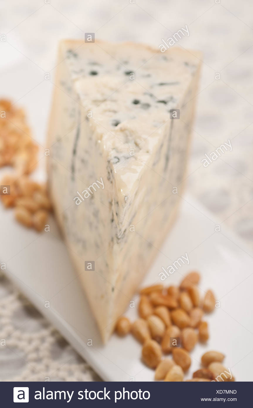 gorgonzola cheese fresh cut and pinenuts - Stock Image
