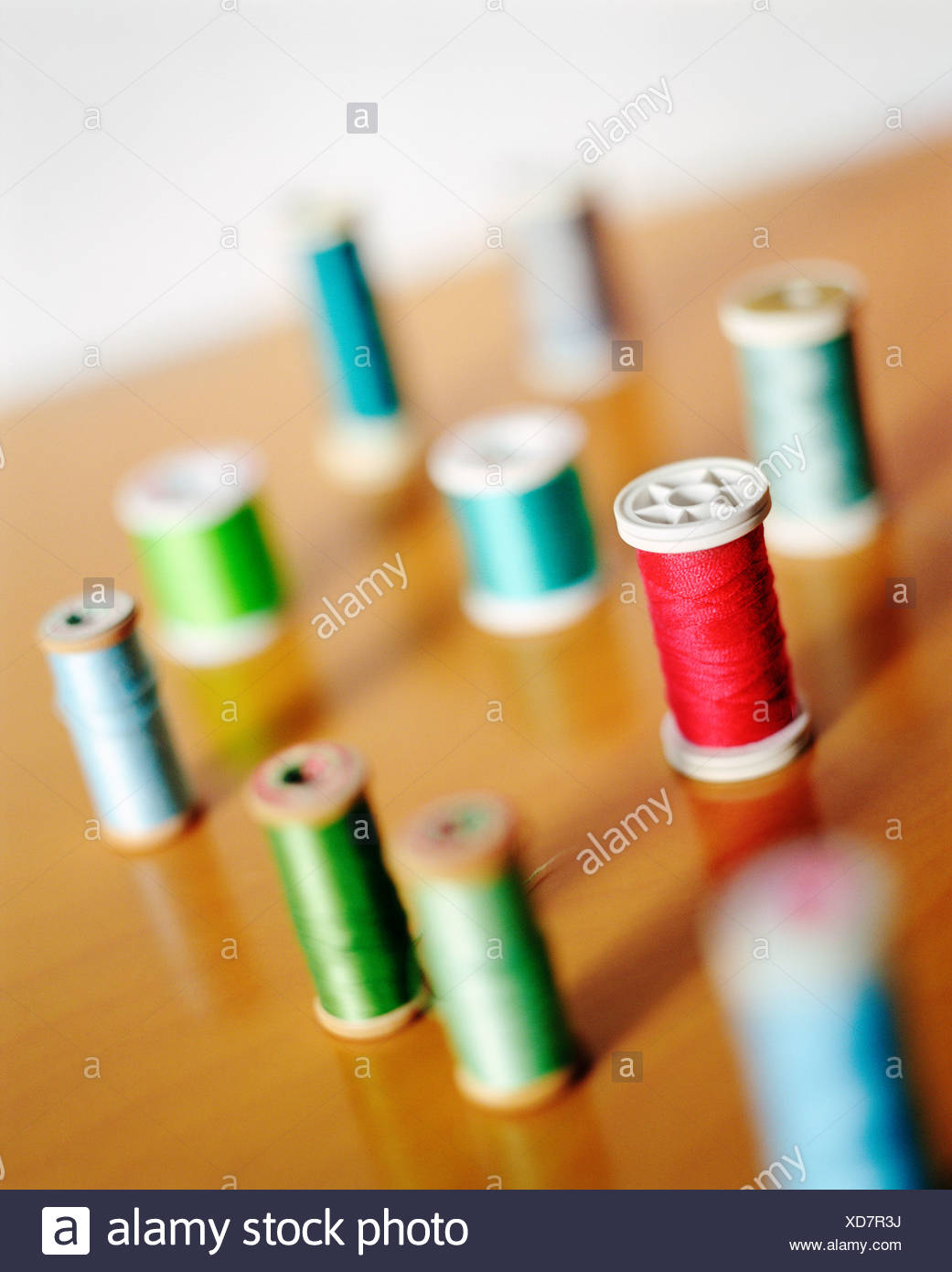 High angle view of spools of thread - Stock Image