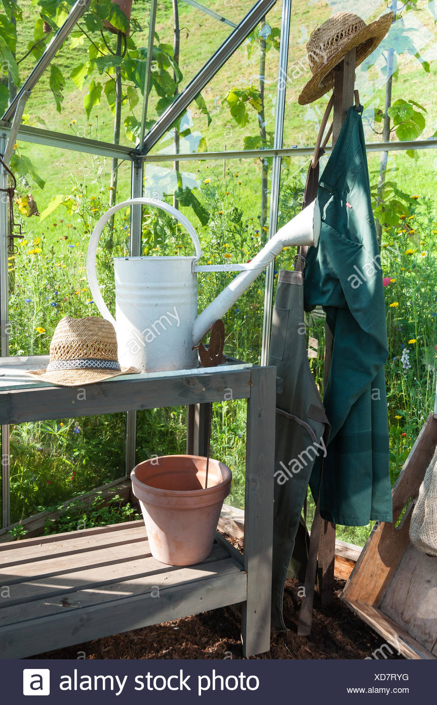Gardener equipment in a greenhouse - Stock Image