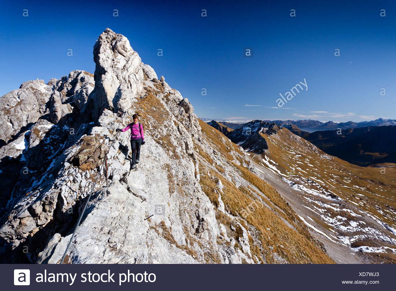 Climber on Bepi Zac climbing route in San Pellegrino Valley above San Pellegrino Pass, overlooking the Bervagabunden Hut Stock Photo