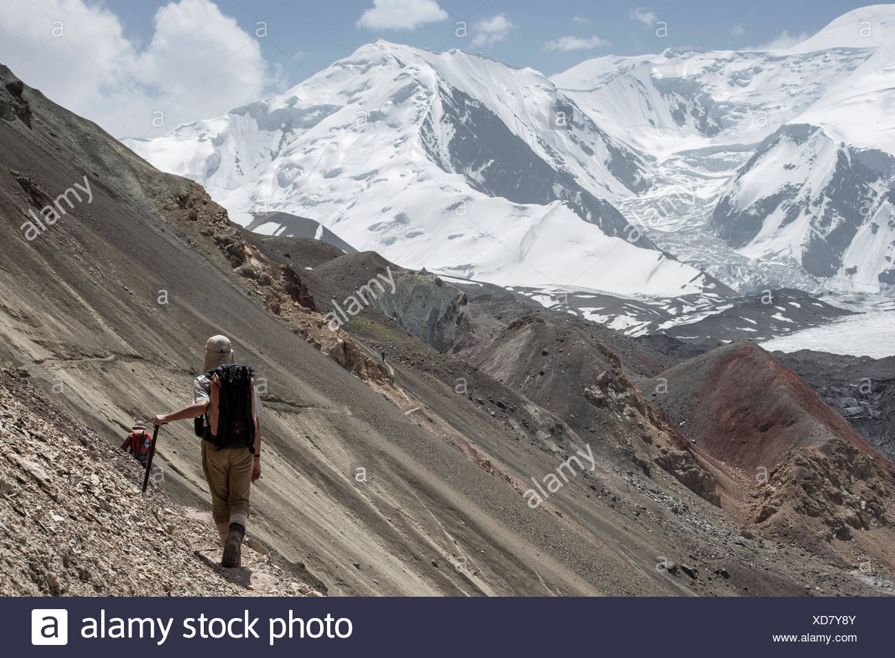 A mountaineer in the approach to advanced basecamp of Peak Lenin Stock Photo