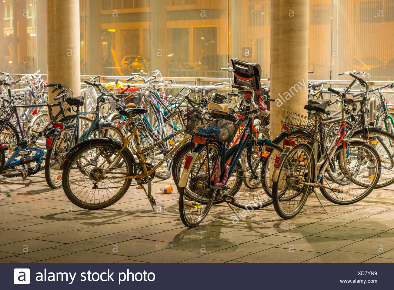 parked bicycles, lights, illumination, Breslau place, Germany, Europe, bicycle parking, bicycles, bikes, Cologne, Cologne centra - Stock Image