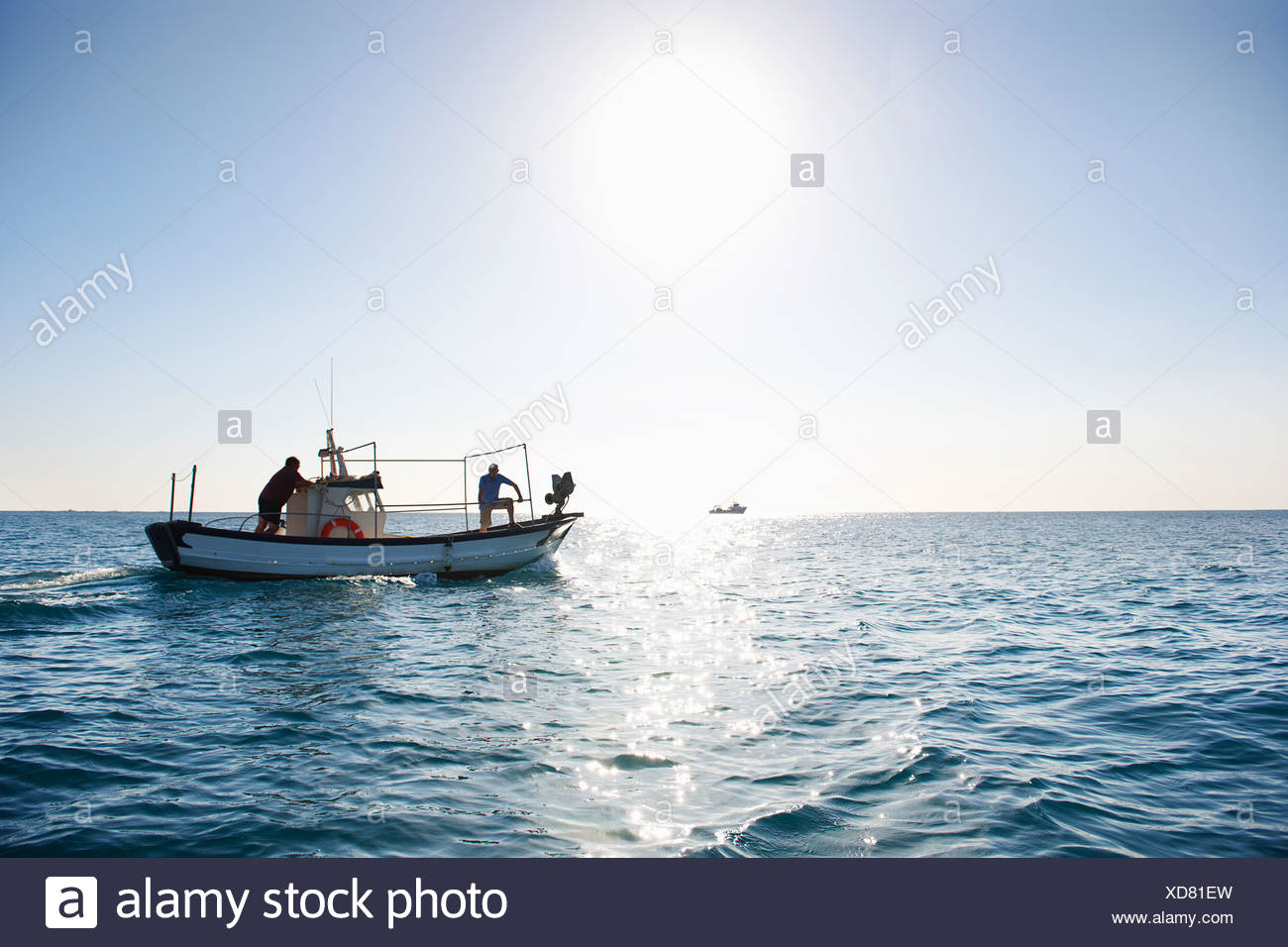 Fishermen on fishing boat at sea - Stock Image